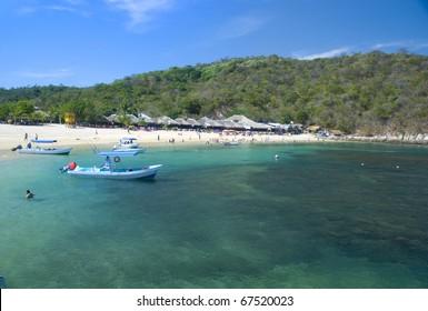 Beautiful tropical beach in Huatulco, Oaxaca, Mexico