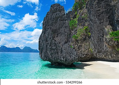 Beautiful tropical beach. Scenic landscape with sandy beach sea and mountain island, El Nido, Palawan, Philippines, Southeast Asia. Sea bay scenery. Popular landmark tourist destination of Philippines
