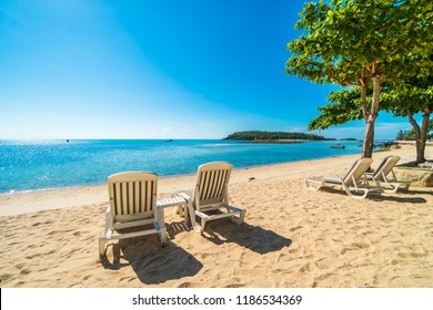 Beautiful tropical beach and sea with chair on blue sky for travel and vacation