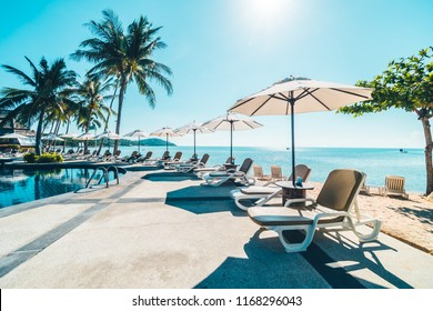 Beautiful tropical beach and sea with umbrella and chair around swimming pool in hotel resort for travel and vacation