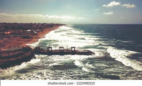 Beautiful tropical beach and sea waves in Nahariya, Israel. Aerial view.