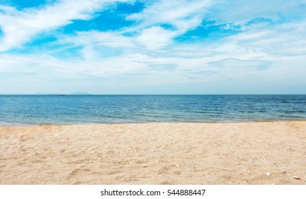 Beautiful tropical beach and sea with white sand,cloud and blue sky background