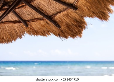 Beautiful tropical beach with white sand and palapa (thatched roof) in the Caribbean, Mexico. Summer beach background.