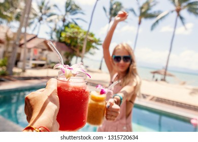 Beautiful with tropical cocktails cheers woman. Celebration & party. Summer beach concept. Nature concept. Restaurant Beverage drink concept. Summer vacation.