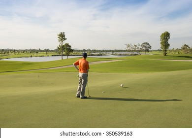 beautiful tropical golf course green grass and fresh blue sky,golf game concept.golf player during putt training.
