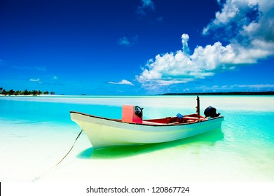 Beautiful tropical lagoon on a deserted island with boat in foreground