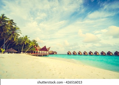 Beautiful tropical Maldives island with beach and sea for nature holiday vacation background concept - Vintage Filter and Boost up color Processing