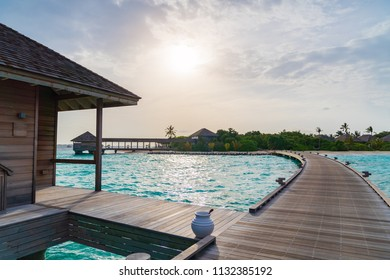 Beautiful tropical Maldives island summer vacation relaxing at overwater villa in luxury resport.