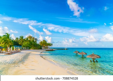 Beautiful tropical Maldives island with white sandy beach and sea