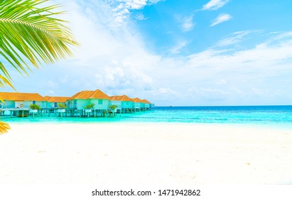 Beautiful tropical Maldives resort hotel and island with beach and sea - holiday vacation background concep