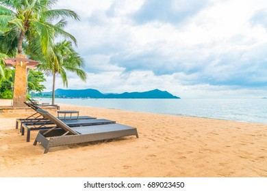 Beautiful tropical ocean or sea and sand beach with coconut palm tree