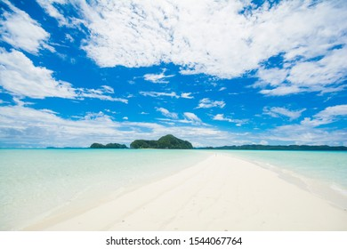 Beautiful tropical ocean and white sand way to the island, Long beach in Rock Island Southern Lagoon, UNESCO world heritage, Palau, Pacific