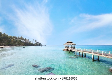 beautiful tropical paradise beach landscape, island with pier in turquoise water