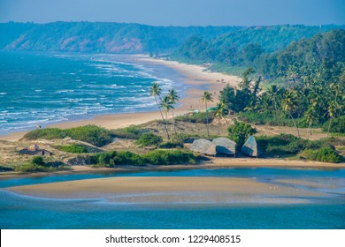 The beautiful tropical sandy beach on North Goa, India. Best holiday winter destination on Asia.