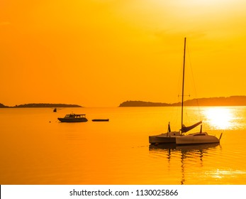 Beautiful tropical sea and ocean with sailboat or yatch at sunrise time