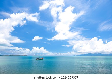 Beautiful tropical seascape. Ocean waves and cloudy sky background. Crystal-blue sea. Ocean water nature, beach relax. Summer sea vacation