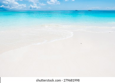 Beautiful tropical summer beach and sea with blue sky - summer vacation using as background