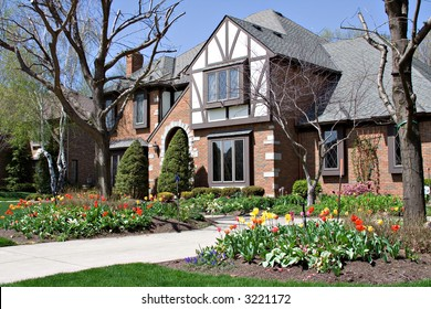 Beautiful tudor home beautifully landscaped with tulips - Ohio.