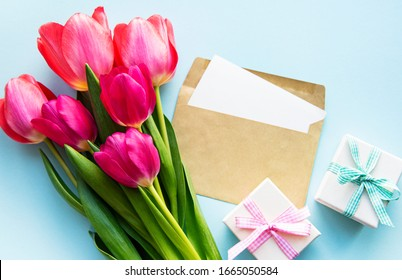 Beautiful tulips bouquet on a blue pastel  background