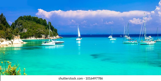 Beautiful turquoise bay Lakka in Paxos with sailing boats. Ionian islands of Greece