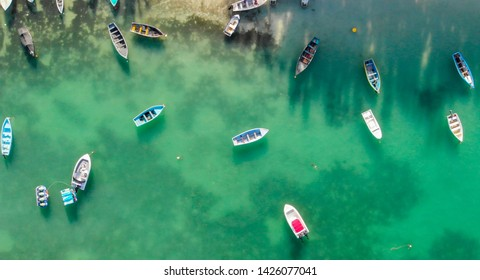 Beautiful turquoise ocean water with boats on the water. Top view aerial photo.