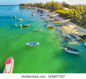Beautiful turquoise ocean water with wooden boats on the water. Top view aerial photo.