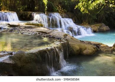 beautiful turquoise waterfall steps