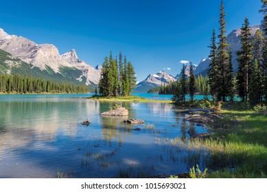 Beautiful turquoise waters of the Maligne Lake and Spirit Island, Jasper National Park, Canadian Rockies.