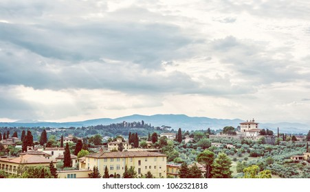 Beautiful Tuscan country. Rural scene. Travel destination. Houses, cypress trees and clouds. Beauty photo filter.