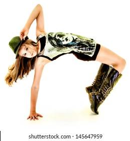 Beautiful Tween Girl Dancing Hip Hop in Studio Over White