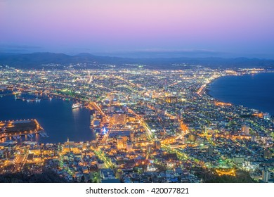 Beautiful twilight of Hakodste's cityscape night view from Hakodate mountain in winter season. Scenery of famous tourist view point in bird eye's view, one of many popular places in Hokkaido, Japan.