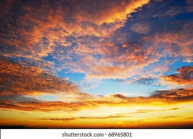 beautiful twilight sunrise scene on cloudy sky