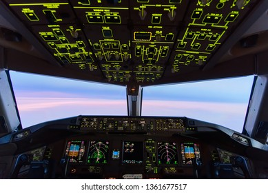 Beautiful twilight sunset sky at high altitude from airplane cockpit view. Inside cockpit can see flight instruments of airplane. Selective focus on panel in the cockpit. Modern aviation concept.