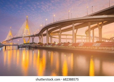 Beautiful twilight tone suspension bridge river front connect intersection overpass highway