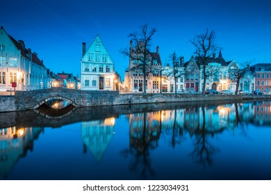 Beautiful twilight view of the historic city center of Brugge with old houses along famous Potterierei canal illuminated during blue hour at dusk, Brugge, Flanders region, Belgium