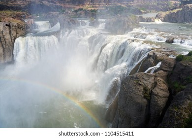 The Beautiful Twin Falls in Idaho with bright rainbow in the mist