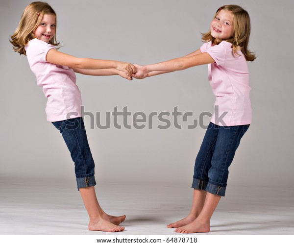 Beautiful twin sisters playing together