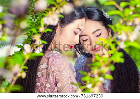 Two Japanese Girls Kissing