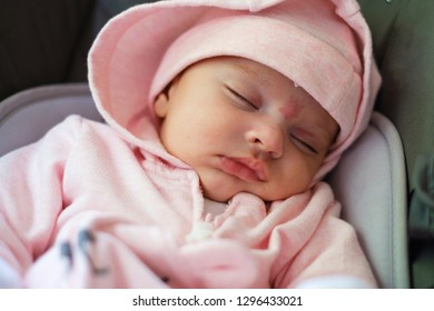 Beautiful two month old baby girl sleeping portrait.