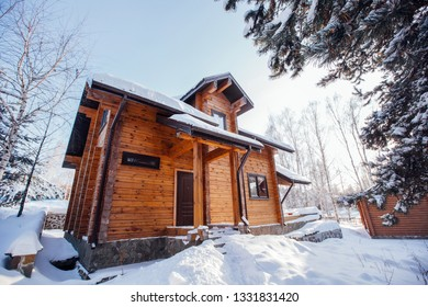 beautiful two-storey wooden house in winter