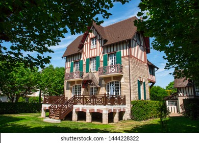 Beautiful typical manor in Cabourg, Normandy, France. Sunny summer day in the city of Marcel Proust. This mansion/villa/house has a unique european timber framing architecture. Luxurious nature.
