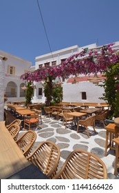 Beautiful Typical White and Blue Square With Restaurants In Chora Island Of Mikonos .Arte History Architecture July 3, 2018. Chora, Mykonos Island, Greece.