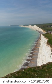 Beautiful UK coast at Birling gap beach and Seven Sisters with white chalk cliffs   and turquoise sea East Sussex England