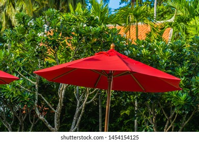 Beautiful umbrella and chair around outdoor swimming pool in hotel resort for holiday vacation travel background