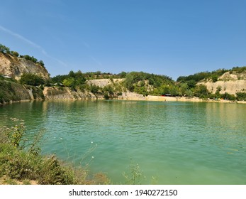 The beautiful and unique Besenovacko Lake (Lake Beli Kamen) on Fruska Gora was created in the pit of a mining mine. A lake of unique color and nature. - Shutterstock ID 1940272150