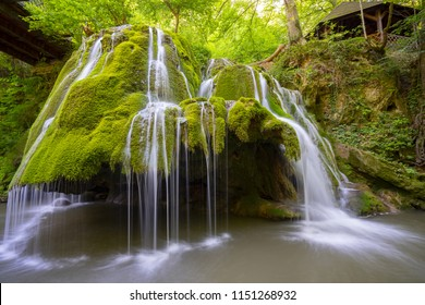 Beautiful unique Bigar Waterfall in Romania on the Edge of the Road passing through the carpatian Mountains