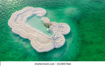 A beautiful and unique island off the shores of the Dead Sea, formed out of salt formations. An isolated tree still stands off the centre.