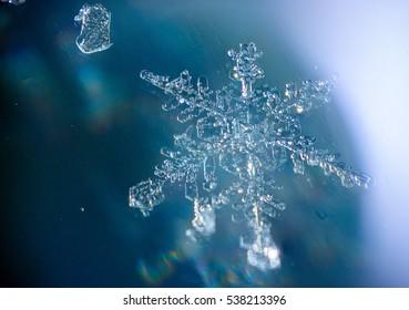 beautiful unique snowflake patterns of frozen snow.