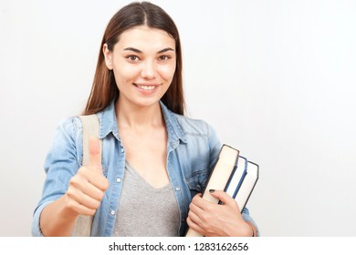 beautiful university student at library