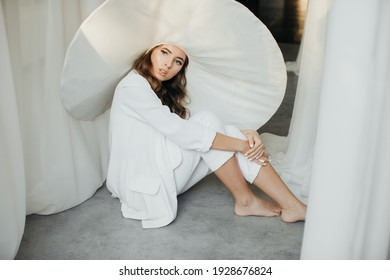 Beautiful unrecognizable bride in a wedding dress and hat. Stunning young bride in a hat. Wedding day. Beautiful portrait of the bride without the groom.